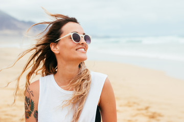 Portrait of smiling and happy woman on the beach