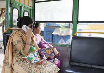 Mother and daughter travelling in a local Bus