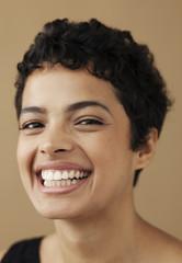 Close portrait of smiling woman.