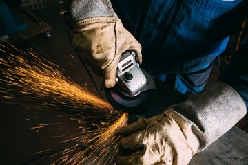 Metal worker with angle grinder