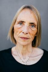 Closeup portrait of a wrinkled senior woman.