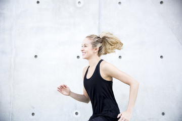 Woman sprinting outdoors