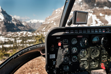 Cockpit of a helicopter landed in a meadow in the Rocky Mountains