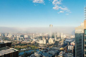 Melbourne city with a line of fog rising on a winter's morning