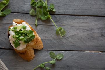 Crostini with ricotta, peas and pea shoots