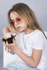 Girl in sunglasses looking at dessert