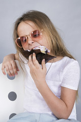 Girl in sunglasses eating dessert