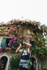 Man taking photo of surroundings in city