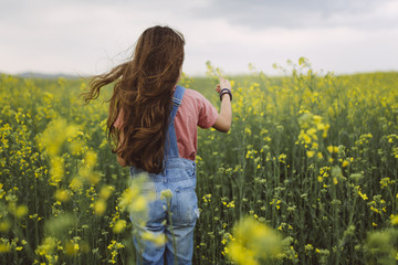 Girl standing in a field.