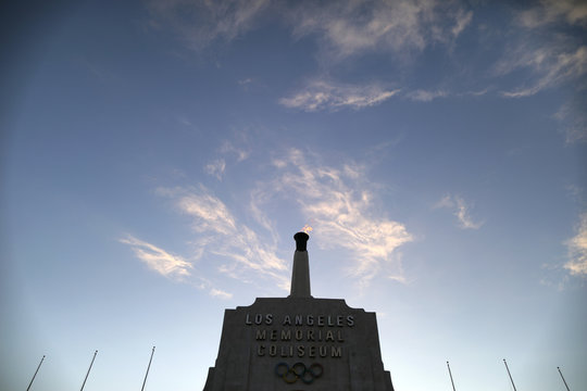 The Olympic flame is seen at the Los Angeles Coliseum on the day Los Angeles was awarded the 2028 Olympic Games, in Los Angeles