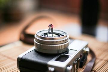small figures cameraman