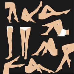 Set of female legs on a black background