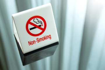 no smoking sign on table in the bedroom