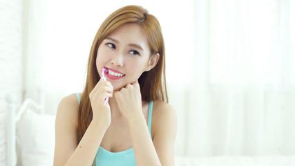 woman take toothbrush