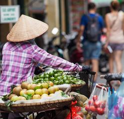 HANOI, VIETNAM - AUGST 2017:  Street vendors selling their goods in Hanoi, Vietnam