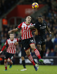 Liverpool's Georginio Wijnaldum in action with Southampton's Oriol Romeu
