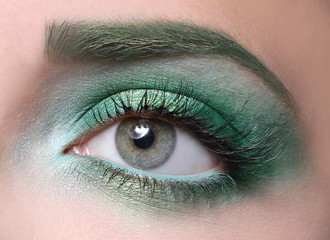 Young woman with bright green makeup, closeup