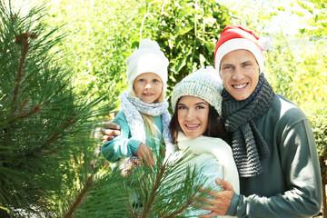 Happy family at Christmas tree market