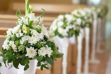 beautiful decor of white flowers in church for a wedding ceremony