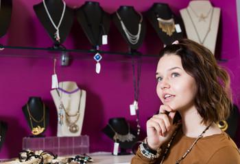 Girl want to buying fashionable bracelets and pendants