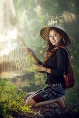 Young asian girl repair net fishing