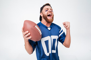 Excited screaming man fan holding rugby ball.