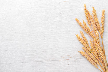 Wheat on a wooden background. Top view. Free space for text.
