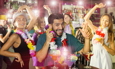 Happy male is having fun on hawaiian party