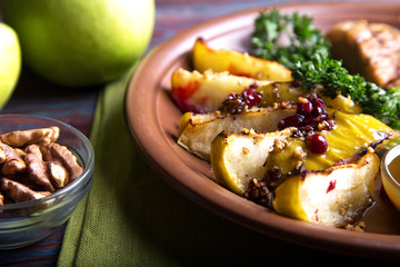Slices of baked apple  with walnut and cranberry
