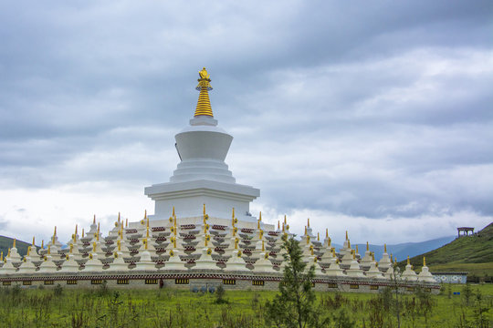 the beautiful white tower of the Tibetan temple in Daocheng, Sichuan, China