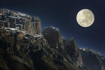 Full moon rising over the mountain range