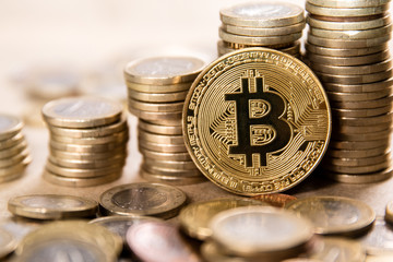 bitcoin on the background of coins of one euro