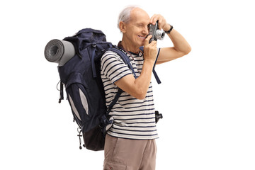 Elderly hiker taking a picture with a camera