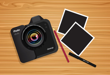 Mockup photo  on a wooden texture. Modern professional DSLR camera. The interior of the workplace.