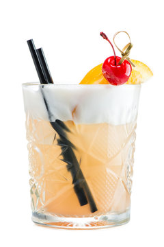 John Collins or Whiskey sour cocktail in glass decorated with cherry, slice of orange and straws isolated on white background