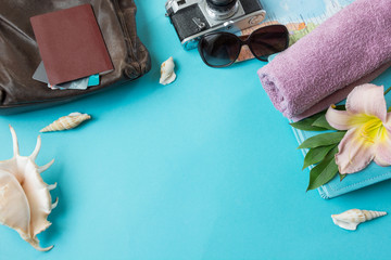 Travel summer accessories with space for text on blue background. Concept of the summer trip.