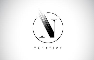 N Brush Stroke Letter Logo Design. Black Paint Logo Leters Icon.