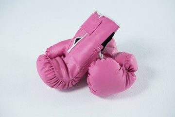 High angle view of pink boxing gloves pair