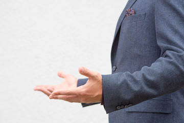 Close up hands of a male public speaker while giving a speech.