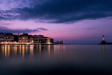 Chania, Crete, Greece: lighthouse in Venetian harbor at blue hour