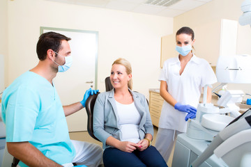 Adult woman getting her checkup at the Dentist