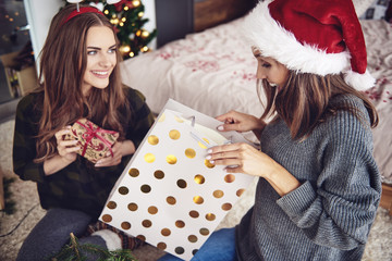 Women giving a christmas present each other