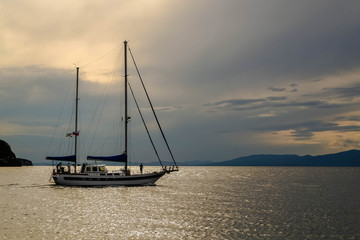Sailboat at sunset in the sea
