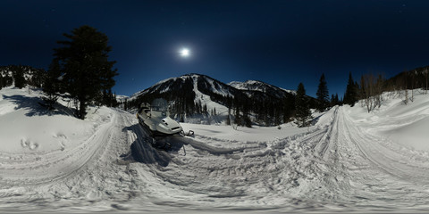 Snowmobile on a moonlit night on the road in the mountains. Spherical 360 180 panorama