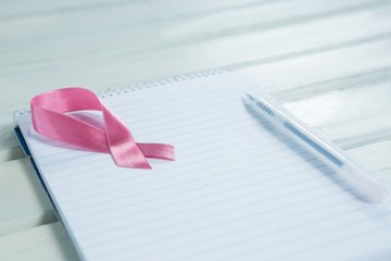 Close-up of pink Breast Cancer Awareness ribbon and spiral