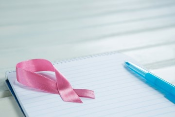 High angle view of pink Breast Cancer Awareness ribbon and