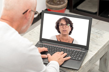 man videochatting with his wife on tablet