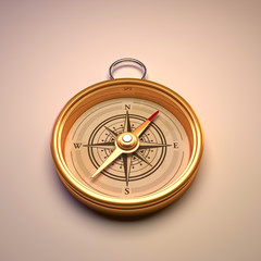 Antique gold compass isolated on background.