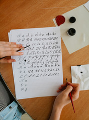 woman write alphabet with straight calligraphy pen