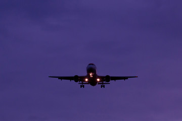 The plane flies up at dusk